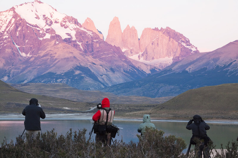 Guests 'at location' during sunrise for shooting, Torres del Paine National Park, Chilean Patagonia © Claudio F. Vidal, Far South Exp
