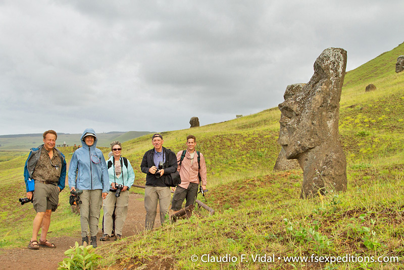 Our guests posing together one of the many unfinished 'moai' at the quarry of Rano Raraku volcano, Easter Island (Rapa Nui) © Claudio F. Vidal, Far South Expeditions