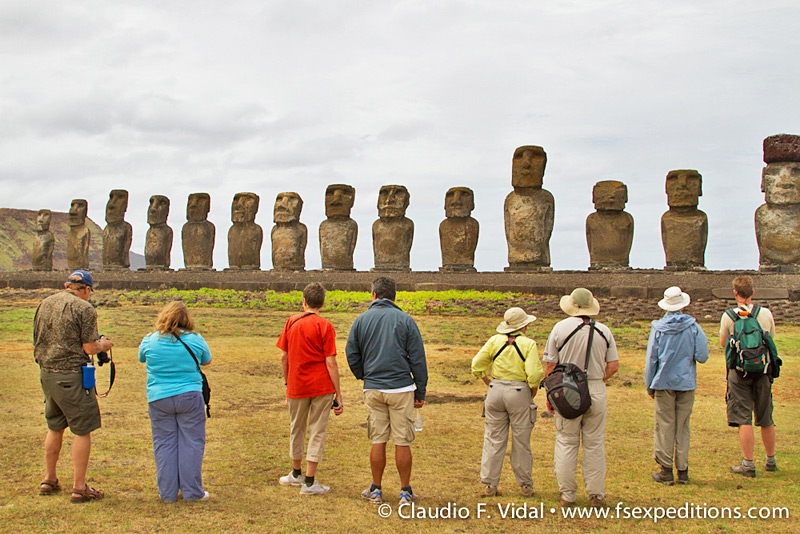 Our local leader Ramon Edmunds and our guests admiring the standing moai at ahu Tongariki © Claudio F. Vidal, Far South Expeditions